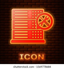 Glowing neon Database server with screwdriver and wrench icon isolated on brick wall background. Adjusting, service, setting, maintenance, repair, fixing.  Vector Illustration