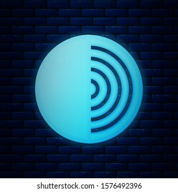 Glowing neon Earth structure icon isolated on brick wall background. Geophysics concept with earth core and section layers earth.  Vector Illustration