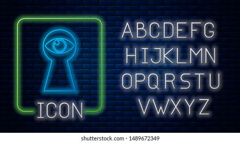 Glowing neon Keyhole with eye icon isolated on brick wall background. The eye looks into the keyhole. Keyhole eye hole. Neon light alphabet. Vector Illustration