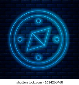 Glowing neon line Compass icon isolated on brick wall background. Windrose navigation symbol. Wind rose sign.  Vector Illustration