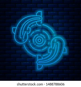 Glowing neon line Fish icon isolated on brick wall background.  Vector Illustration