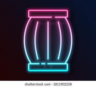 Glowing neon line Gun powder barrel icon isolated on black background. TNT dynamite wooden old barrel.  Vector