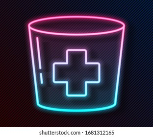 Glowing neon line Nurse hat with cross icon isolated on black background. Medical nurse cap sign.  Vector Illustration
