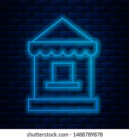 Glowing neon line Ticket box office icon isolated on brick wall background. Ticket booth for the sale of tickets for attractions and sports.  Vector Illustration