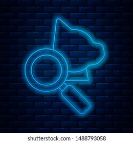 Glowing neon line Veterinary clinic symbol icon isolated on brick wall background. Magnifying glass with cat veterinary care. Pet First Aid sign.  Vector Illustration