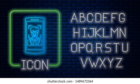 Glowing neon Mobile phone and face recognition icon isolated on brick wall background. Face identification scanner icon. Facial id. Cyber security. Neon light alphabet. Vector Illustration