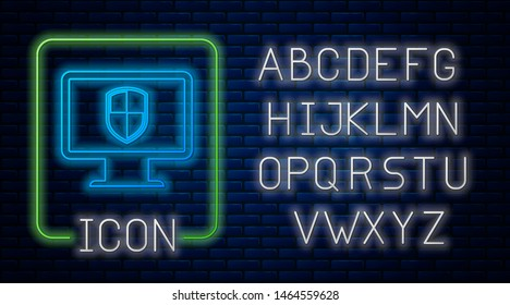Glowing neon Monitor and shield icon isolated on brick wall background. Computer security, firewall technology, internet privacy safety or antivirus. Neon light alphabet. Vector Illustration