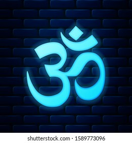 Glowing neon Om or Aum Indian sacred sound icon on brick wall background. Symbol of Buddhism and Hinduism religions. The symbol of the divine triad of Brahma, Vishnu and Shiva. Vector Illustration