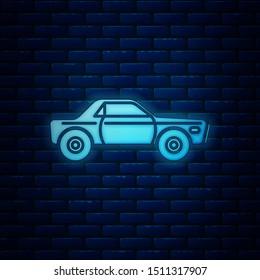 Glowing neon Sedan car icon isolated on brick wall background.  Vector Illustration