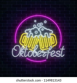 Glowing neon sign of octoberfest festival with two beer mugs on dark brick wall background. Beer fest logo. Vector illustration.
