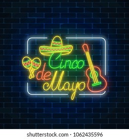 Glowing neon sinco de mayo holiday sign in rectangle frame on dark brick wall background. Mexican festival flyer.