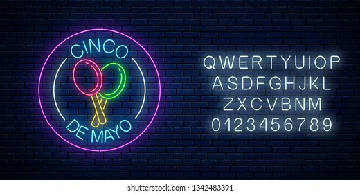 Glowing neon sinco de mayo holiday sign in circle frames with alphabet on dark brick wall background. Mexican festival flyer design. Vector illustration.