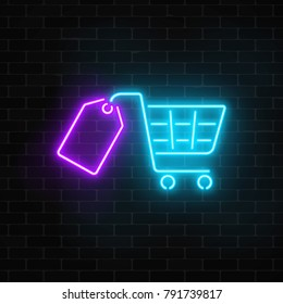 Glowing neon supermarket shopping cart with tag sign on a dark brick wall background. Luminous advertising signboard. Neon light effects store basket. Vector illustration.