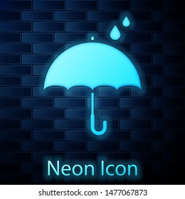 Glowing neon Umbrella and rain drops icon isolated on brick wall background. Waterproof icon. Protection, safety, security concept. Water resistant symbol.  Vector Illustration