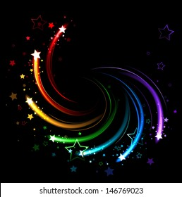 Glowing sparks of all colors of rainbow twist on black background.