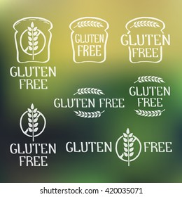 Gluten free- handdrawn isolated logo elements on blurred backdrop. Unique design for ads, signboards, packaging and identity and web sites. Logotypes created with rough effect. Vector illustration.