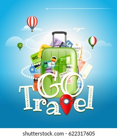 Go travel concept. Travel bag and different touristic elements