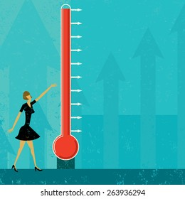 Goal Thermometer A woman measuring the progress of a large fund raising thermometer. The level of mercury is easy to move up and down.