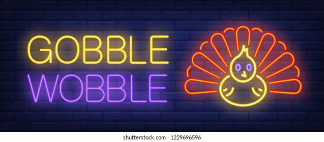 Gobble wobble neon text with turkey. Thanksgiving Day advertisement design. Night bright neon sign, colorful billboard, light banner. Vector illustration in neon style.