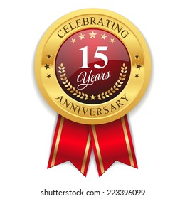 Gold 15 years anniversary badge with red ribbon on white background