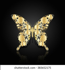 Gold abstract butterfly with floral pattern on black background.