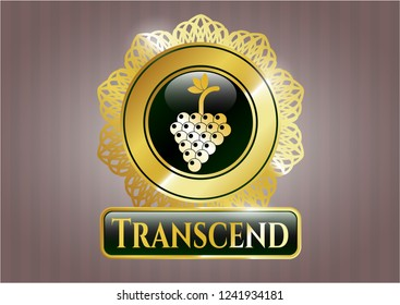 Gold badge with bunch of grapes icon and Transcend text inside