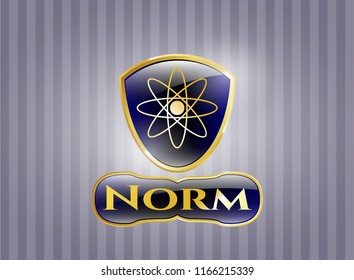 Gold badge or emblem with atom icon and Norm text inside