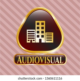 Gold badge or emblem with buildings icon and Audiovisual text inside