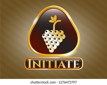 Gold badge or emblem with bunch of grapes icon and Initiate text inside