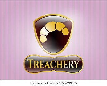 Gold badge or emblem with croissant icon and Treachery text inside