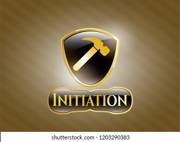 Gold badge or emblem with hammer icon and Initiation text inside
