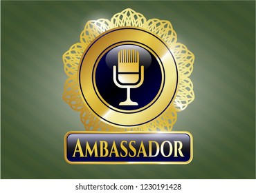 Gold badge or emblem with microphone icon and Ambassador text inside