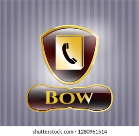 Gold badge or emblem with phonebook icon and Bow text inside