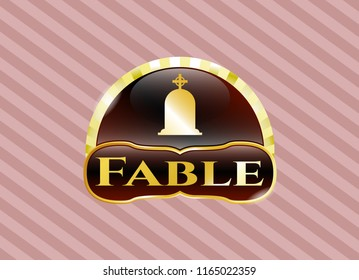 Gold badge or emblem with tombstone icon and Fable text inside