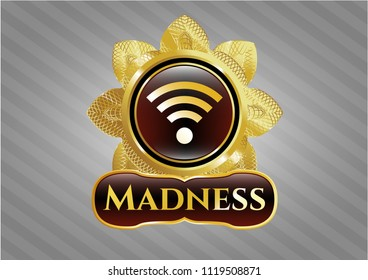Gold badge with wifi signal icon and Madness text inside