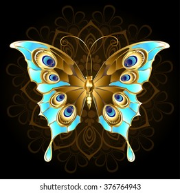 Gold, butterfly jewelry, decorated with turquoise on black background.