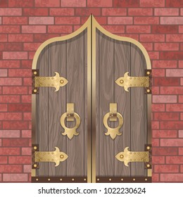 Gold Castle Gate Vintage wooden door with metal border and lock on red brick wall Background