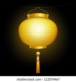 Gold Chinese traditional paper lantern. On black background.