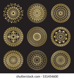 Gold color round abstract ethnic ornament mandalas. Based on old greek, arabic and turkish motifs. For textile, invitations, banners and other