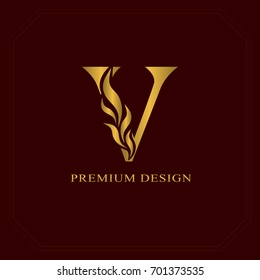 Gold Elegant letter V. Graceful style. Calligraphic beautiful logo. Vintage drawn emblem for book design, brand name, business card, Restaurant, Boutique, Hotel. Vector illustration