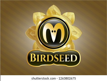 Gold emblem or badge with goat head icon and Birdseed text inside