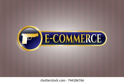 Gold emblem or badge with pistol icon and e-commerce text inside