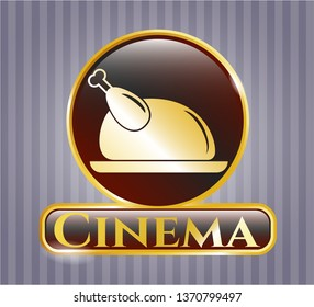 Gold emblem with chicken dish icon and Cinema text inside