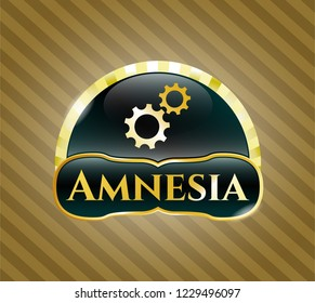 Gold emblem with gear, team work icon and Amnesia text inside