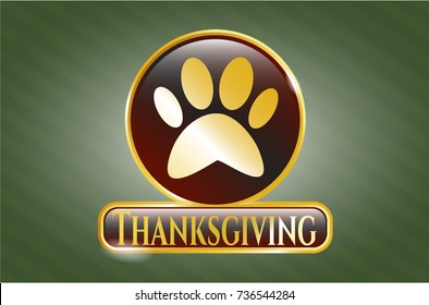 Gold emblem with paw icon and Thanksgiving text inside