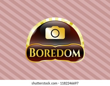 Gold emblem with photo camera icon and Boredom text inside