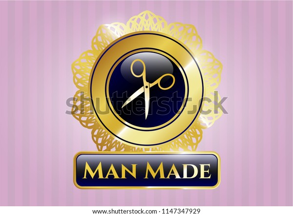Gold emblem with scissors icon and Man Made text inside
