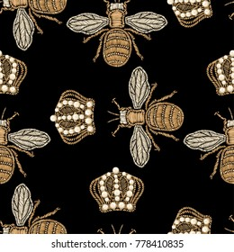 Gold embroidery bee and crown on a black background.