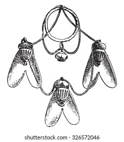 Gold flies hanging from an Egyptian necklace, vintage engraved illustration. Private life of Ancient-Antique family-1881.