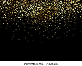 Gold glitter texture over black background. Abstract golden sparkles of confetti.